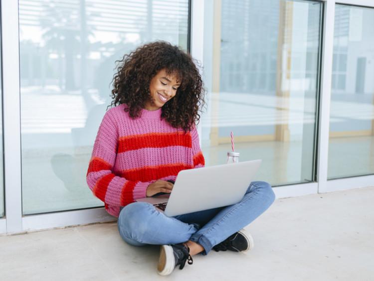 college student working on her online class outside