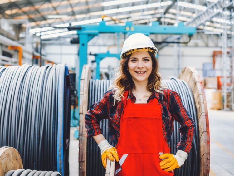young mechanical engineer woman working in a factory