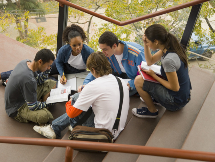 college students studying on campus steps