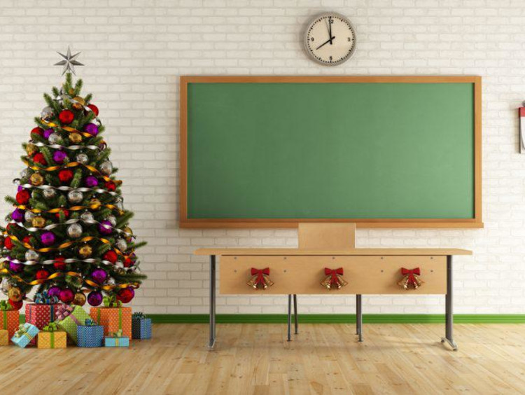 Christmas tree next to blackboard