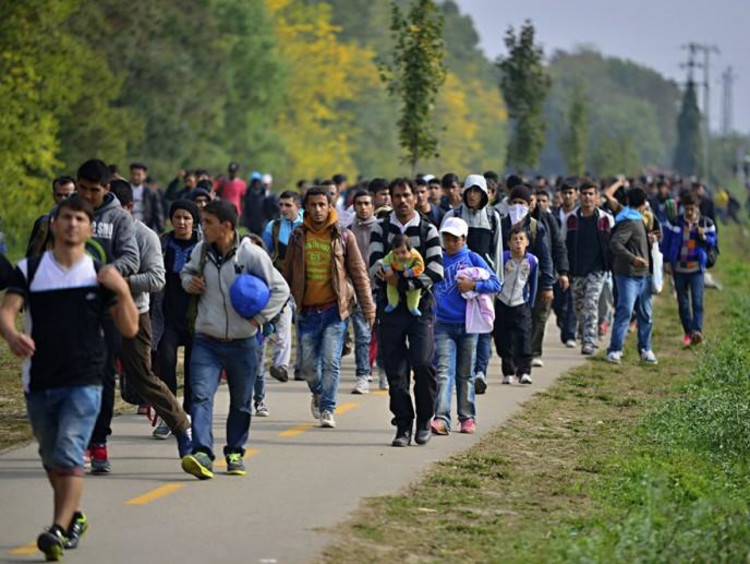 lots of people walking on sidewalk