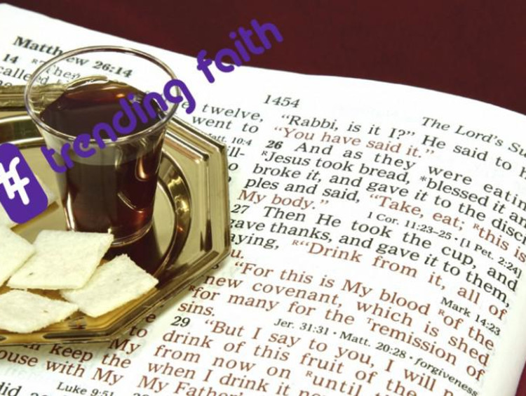 Communion wafers and wine sitting on the Bible with the Trending Faith logo