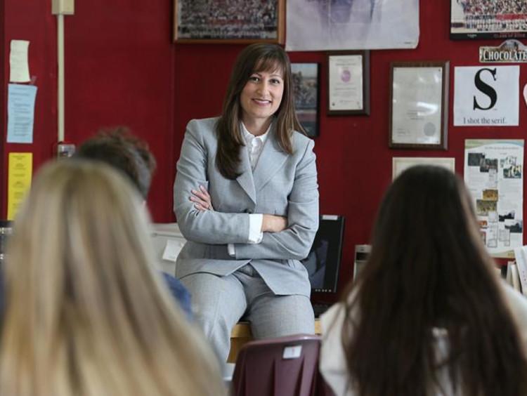 woman teaching students