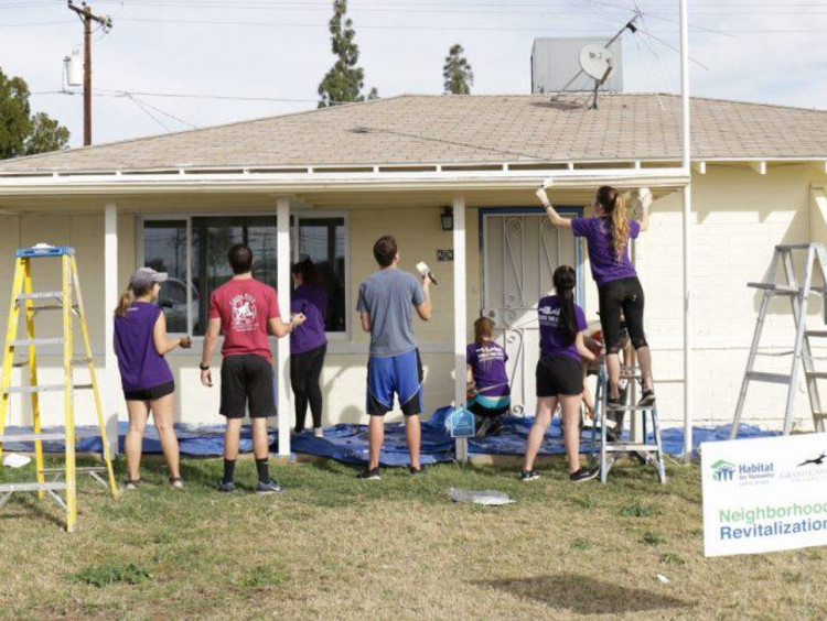 A group of volunteers working on a house