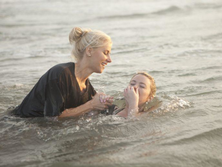 person getting baptised