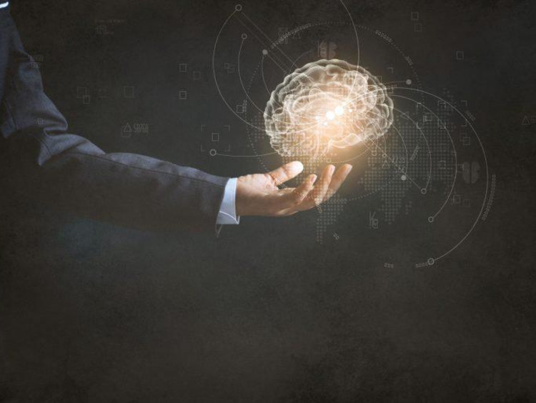Professional man holds glowing orb of intellectual principles