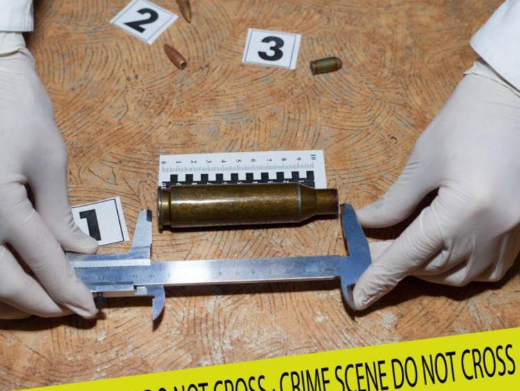 forensic scientist measuring something