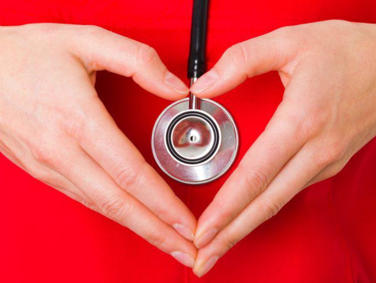 stethoscope with heart hands around it