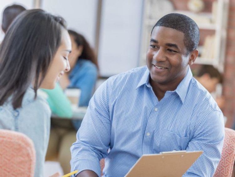 PhD students and counseling discuss courses