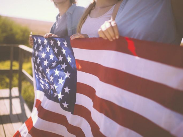 family holding american flag