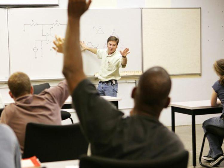 Man raising hand in class