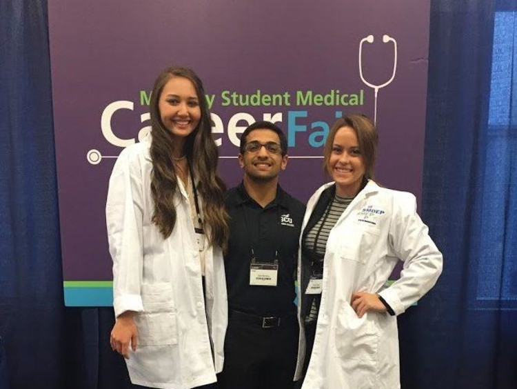 Emily Ghena and 2 other students at Minority Student Medical Career Fair