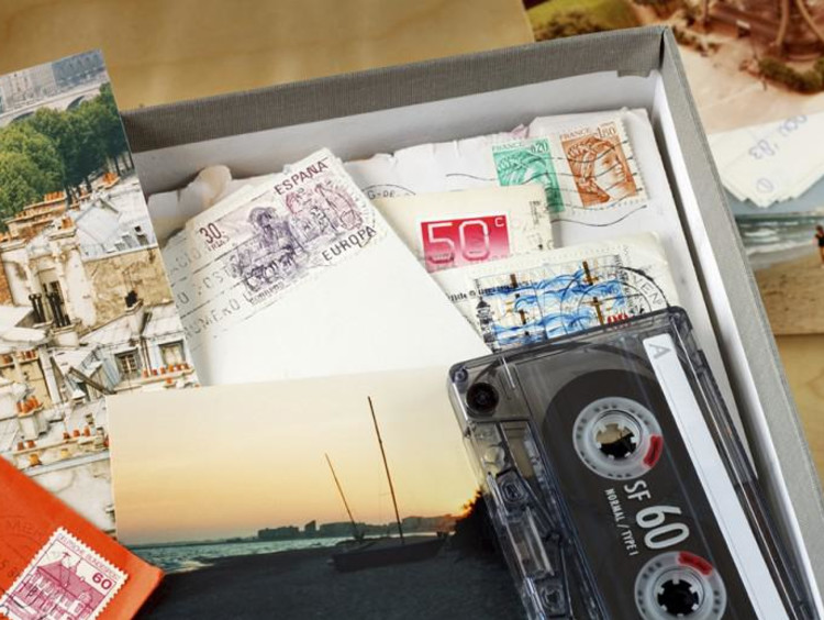 Box of postcards and cassette taps