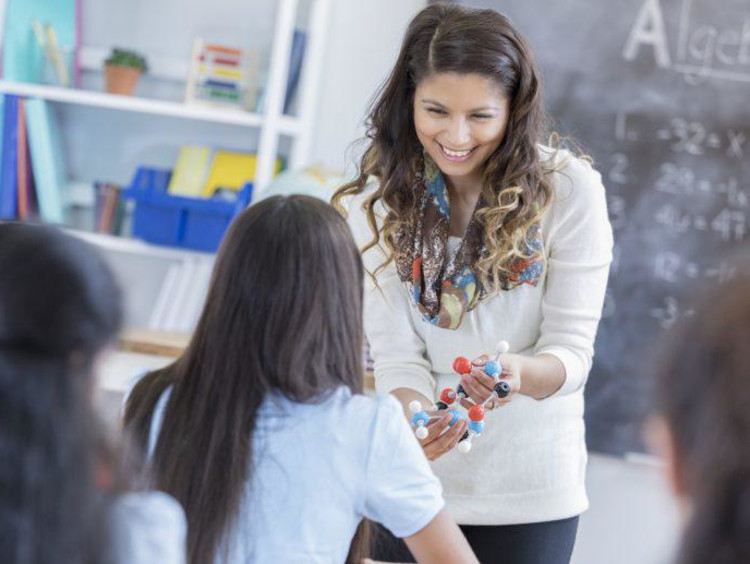 Teacher holding a display for a student
