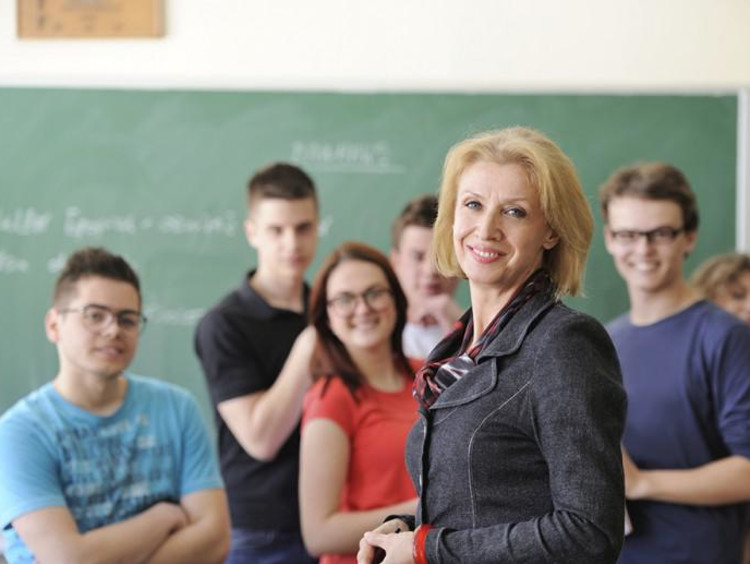 Teacher with students in the background