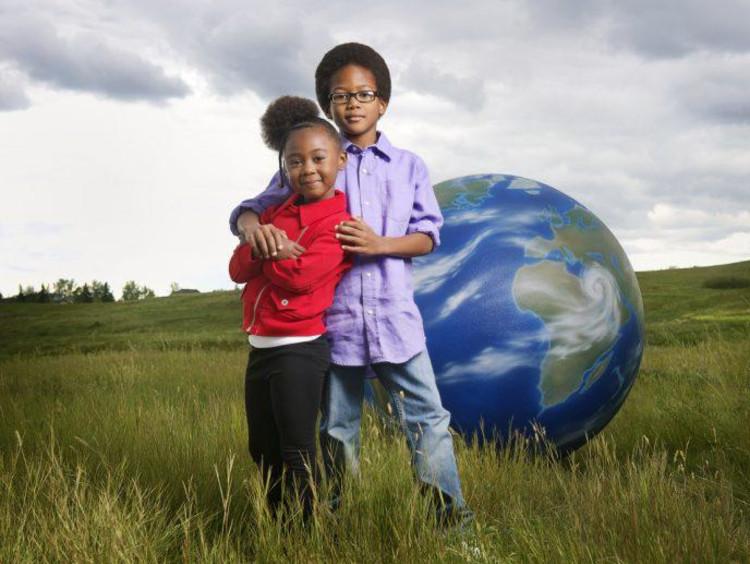 children with globe behind them