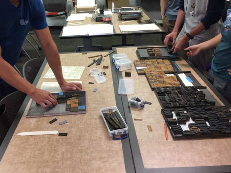 Students typesetting with wood type