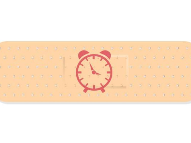 Time heals all pain concept with red alarm clock on top of bandaid
