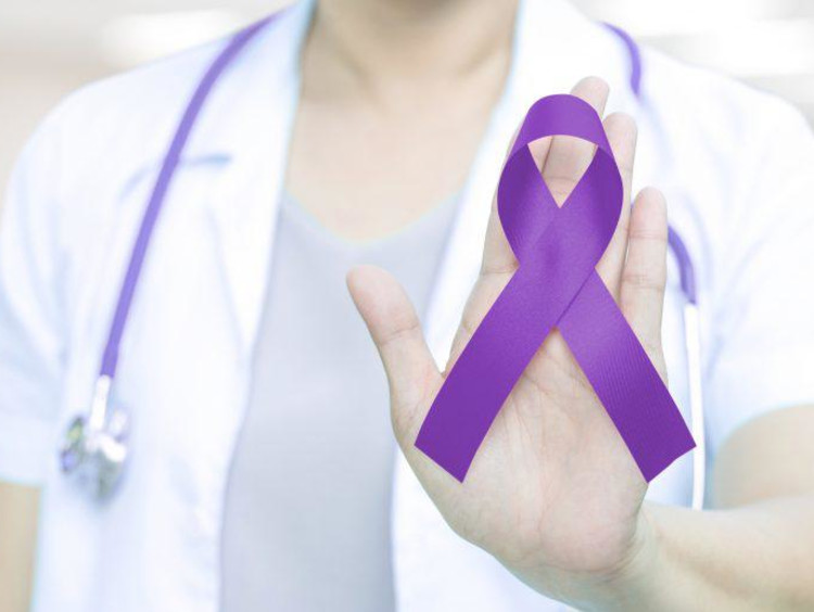Nurse with a purple Alzheimer's ribbon