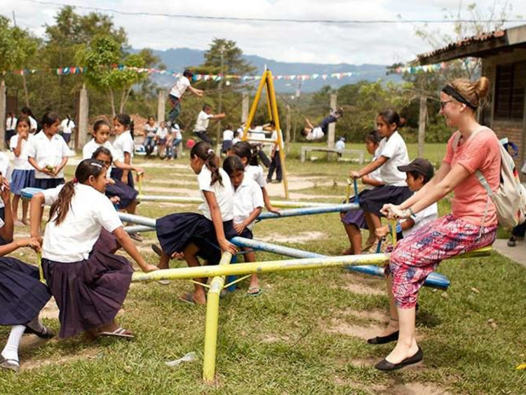 Children play outside in schoolyard setting