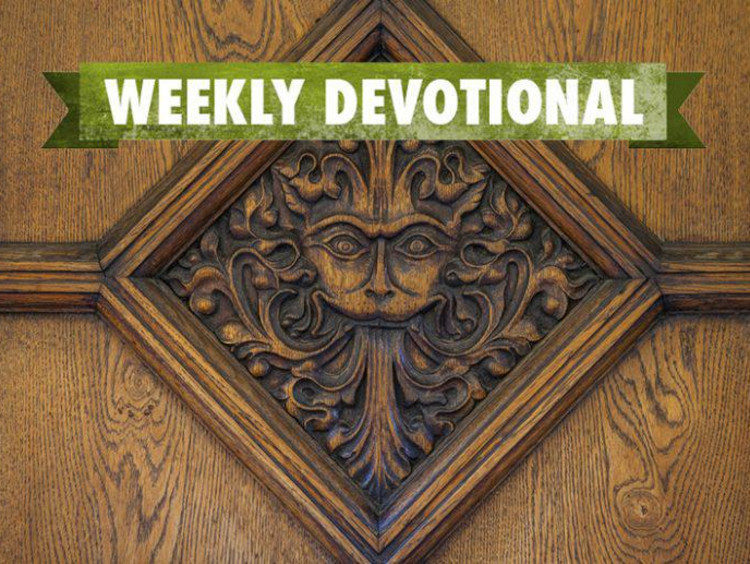 Weekly Devotional: Wooden tile with a face engraved