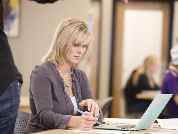 woman writing her dissertation
