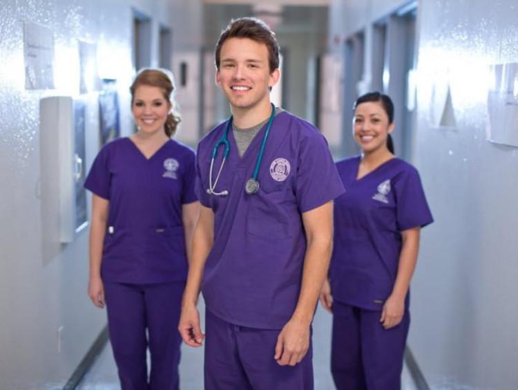 three gcu nursing students in a hallway