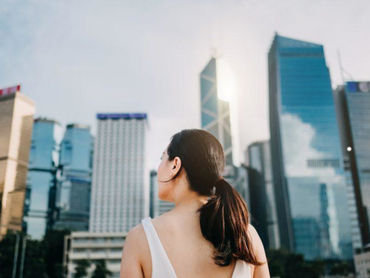 Girl looking at skyscrapers