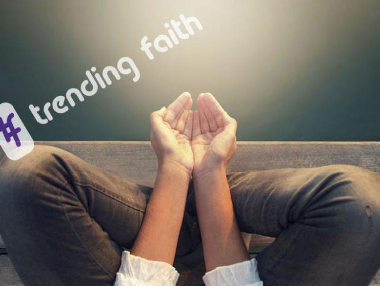 A pair of open hands under the Trending Faith logo