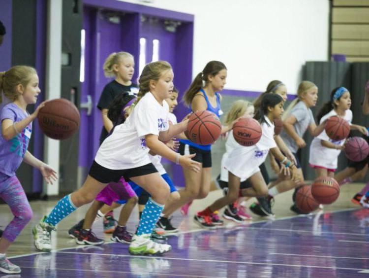 kids playing with basketballs