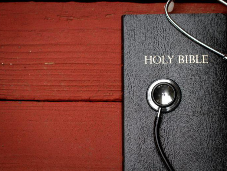 Bible with a stethoscope on top