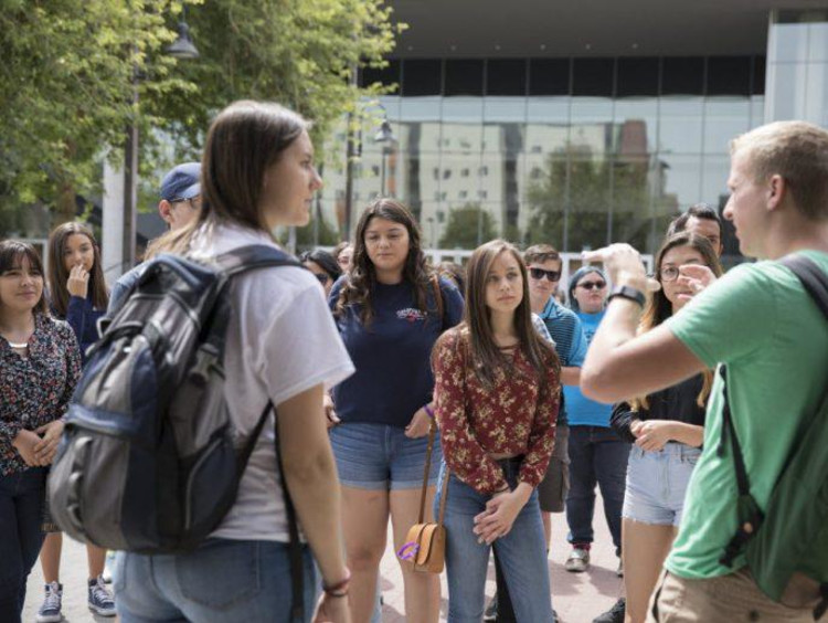 A group of students touring campus