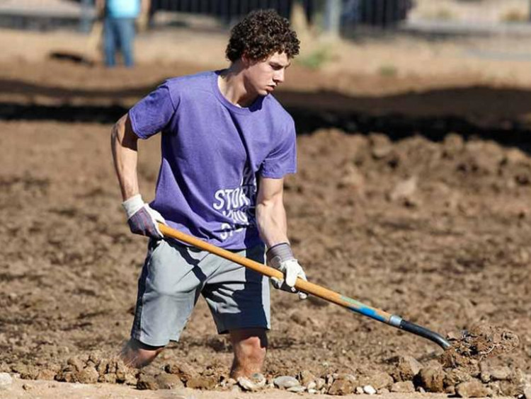 GCU Student doing yard work