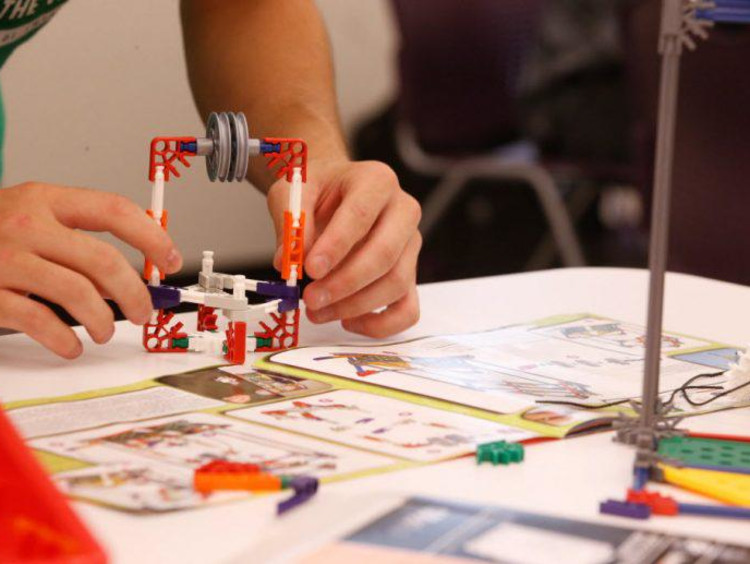 stem student building a prototype