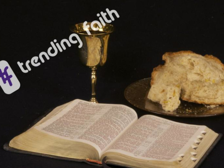 open bible and bread and a cup
