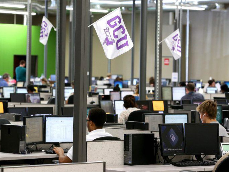 gcu employees on the computer