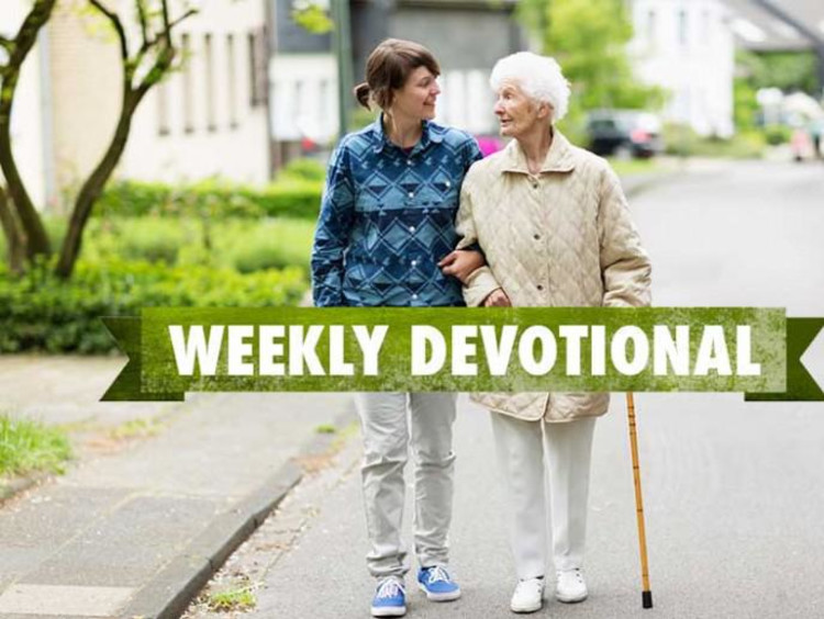 Young man helps elderly female go for a walk with weekly devotional text layered on top of image