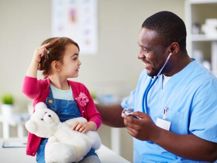 Male nurse helping little girl