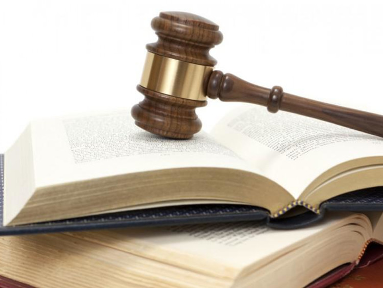 a gavel on top of a Bible