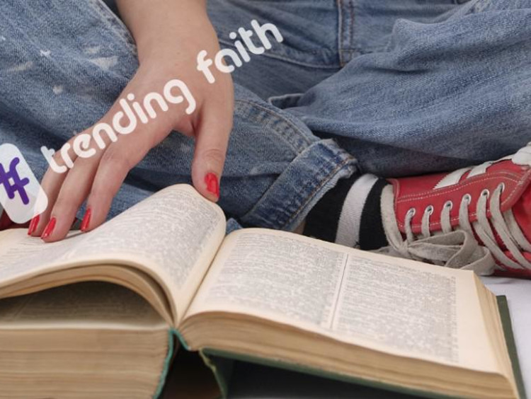 A student reading the Bible under the Trending Faith logo