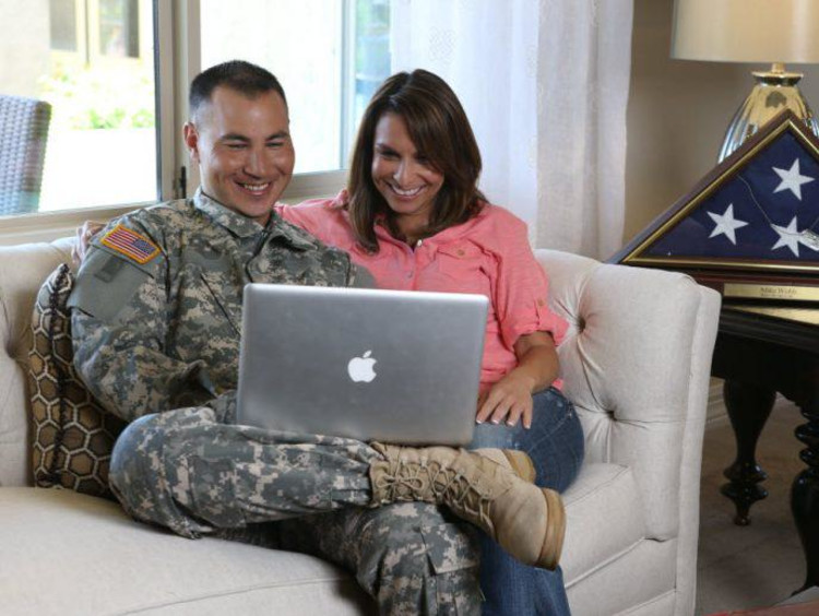 military student sitting on couch