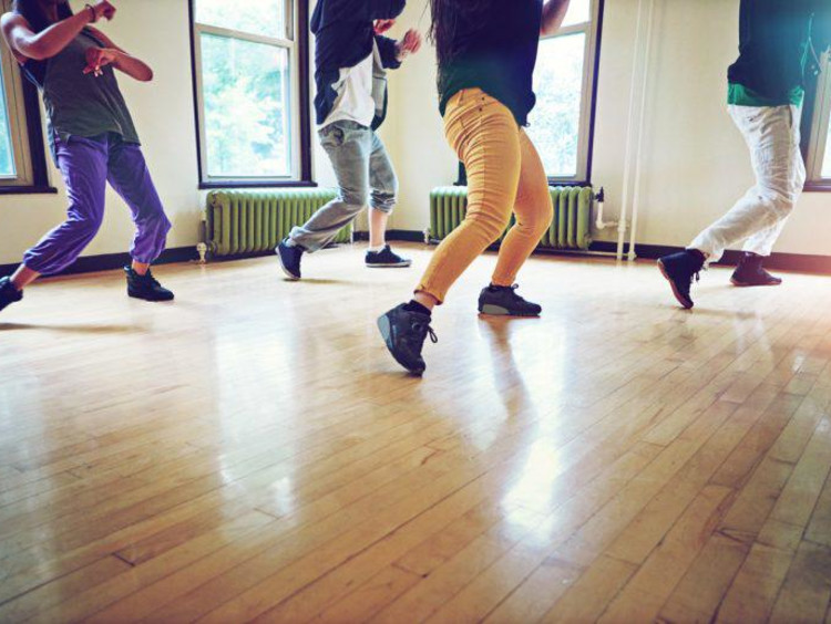 Dancers on a wooden floor