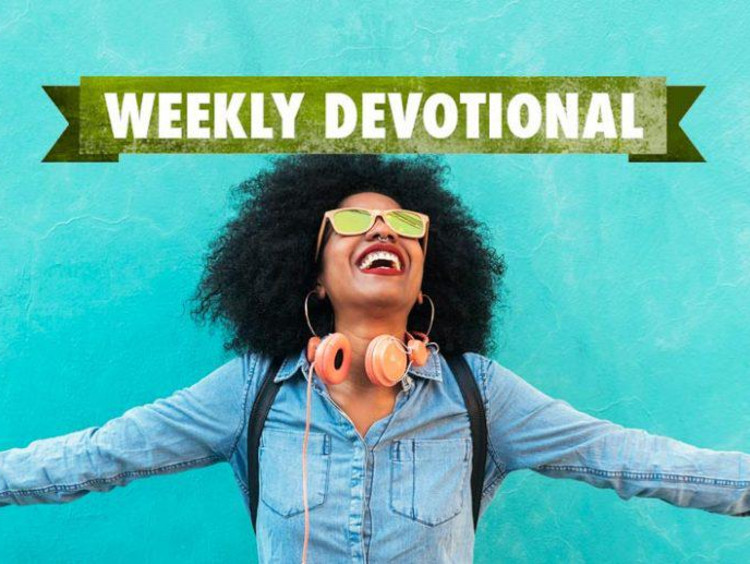Weekly Devotional: Girl with headphones with arms stretched out