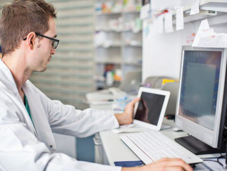 doctor looking at screen