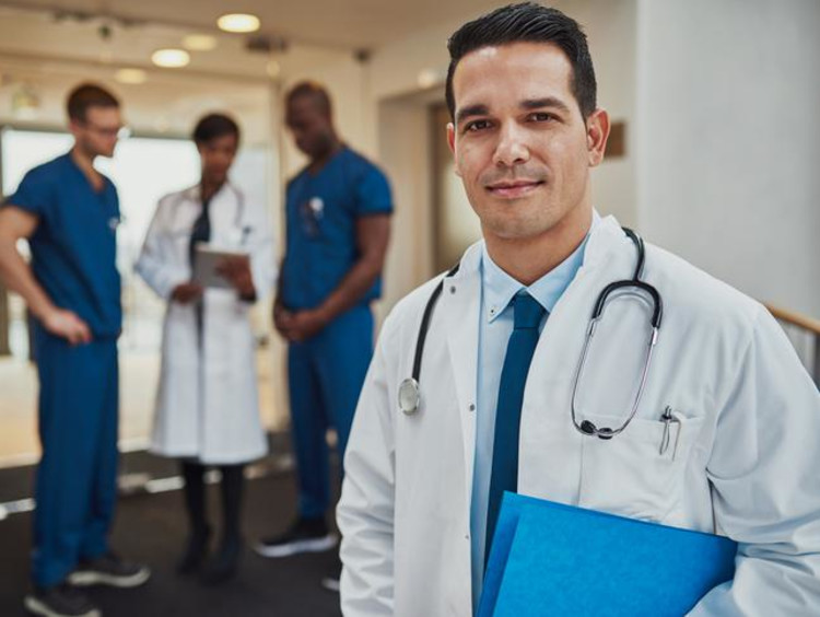 a doctor standing in front of other doctors