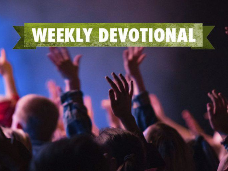 Weekly Devotional: Group of people with their hands in the air