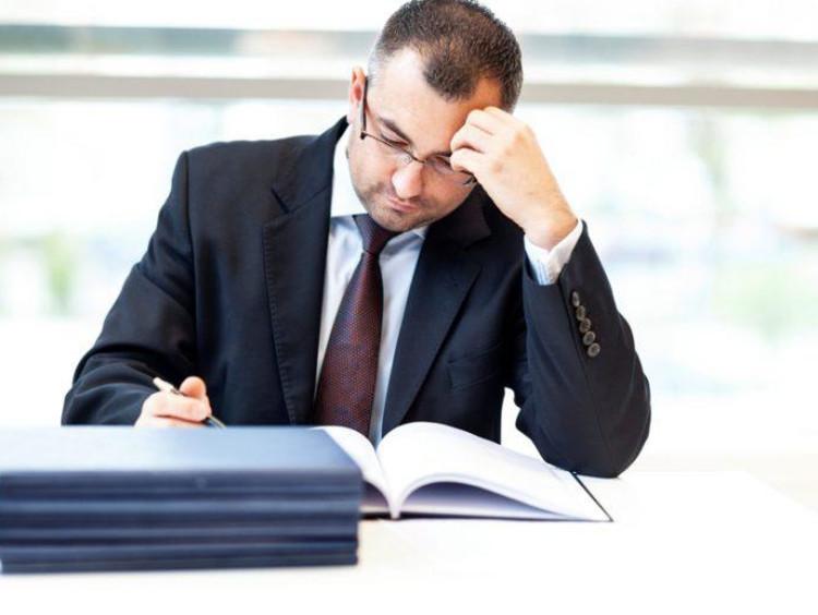 man stressed writing his dissertation