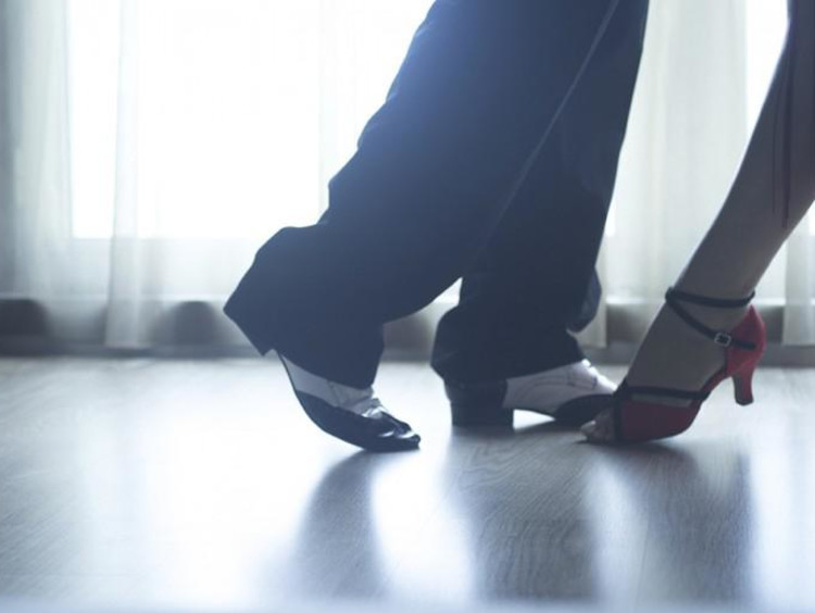 Foot view of two dancers about to do the Tango dance
