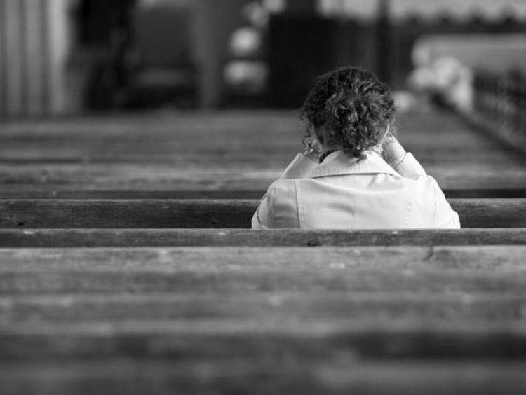 girl sitting in church