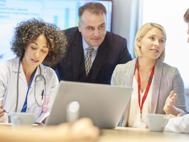 health care professionals talking together